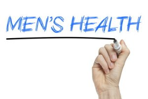 Hand writing men's health on a white board - health concept
